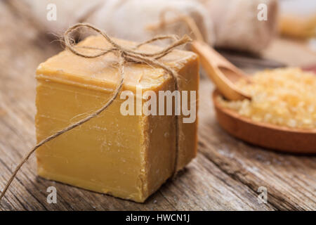 Natural handmade soap bar on wooden background - Stock Photo
