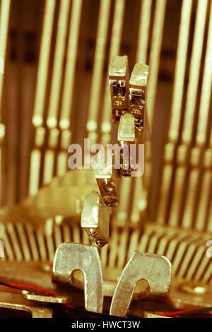 Types of an old typewriter. Symbolic photo for harassment and chaos, Typen einer alten Schreibmaschine. Symbolfoto - Stock Photo