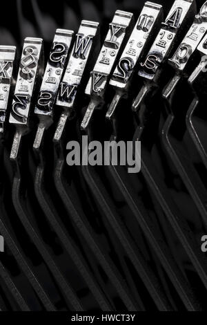 Types and letters of an old typewriter. Symbolic photo for communication in former times, Typen und Buchstaben einer - Stock Photo