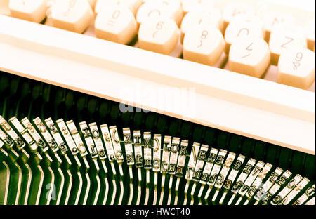 Keys of an old typewriter. Symbolic photo for communication in former times, Tasten einer alten Schreibmaschine. - Stock Photo