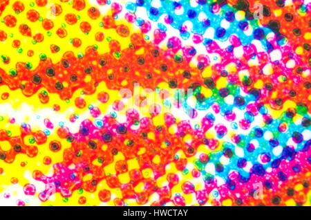 Four color printing on a plastic surface under the microscope. CMYK Cyan Magenta Yellow and Key or black color process. - Stock Photo