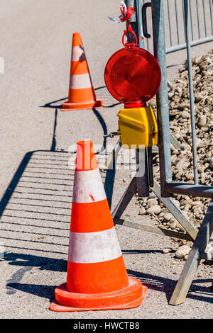 Security by leading cone at a road construction place, Absicherung durch Leitkegel bei einer Strassenbaustelle - Stock Photo