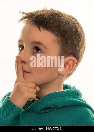 A boy thinks. Pensive or curious child., Ein Bub denkt nach. Nachdenkliches oder neugieriges Kind. - Stock Photo