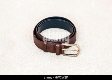 Brown wedding leather men's belt. Groom accessories. - Stock Photo