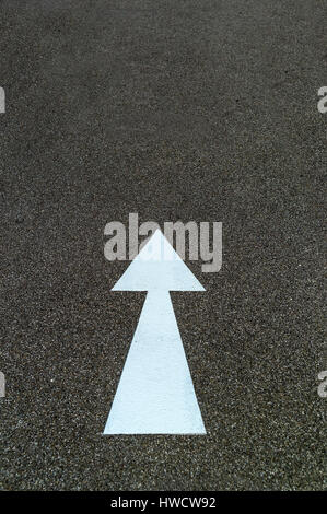Arrow as a direction mark on a cycle track in Linz, Austria, Pfeil als Richtungsmarkierung auf einem Radweg in Linz, - Stock Photo