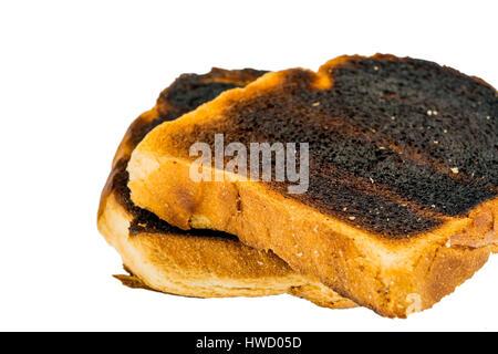 Toast bread became with drink a toast burntly. Burnt toast discs, Toastbrot wurde beim toasten verbrannt. Verbrannte Toastscheiben