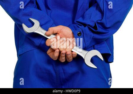 A worker in an industrial concern (craftsman) with tools in the hand, Ein Arbeiter in einem Gewerbebetrieb ( Handwerker - Stock Photo