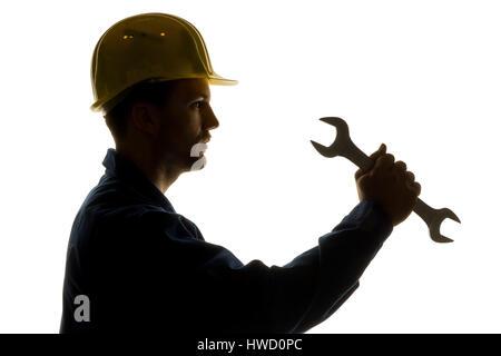 A worker in an industrial concern craftsman with tools in the hand, Ein Arbeiter in einem Gewerbebetrieb ( Handwerker - Stock Photo