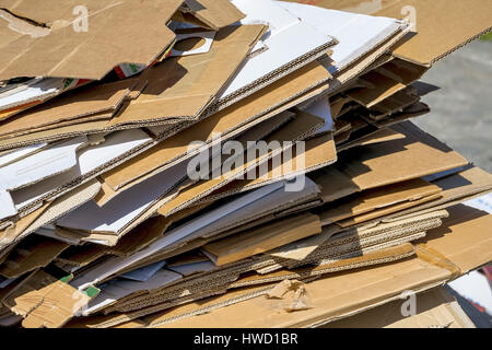 Cardboards wait for the collection by the garbage disposal. Recycling of waste paper., Kartons warten auf die Abholung - Stock Photo