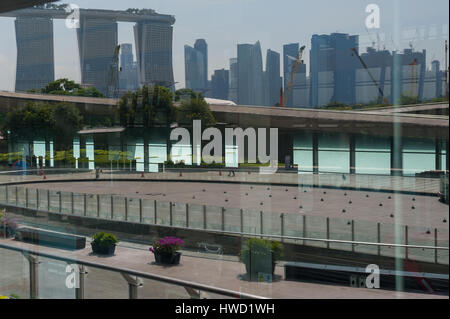 24.09.2016, Singapore, Republic of Singapore - The financial district and the Marina Bay Sands Hotel are reflected - Stock Photo