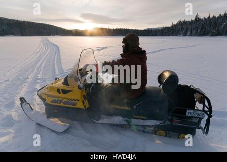 Canada, Quebec, Charlevoix, Saint-Urbain, Grands-Jardins National Park, Lake Moreau Lodge, Auberge du Ravage, snowmobile - Stock Photo