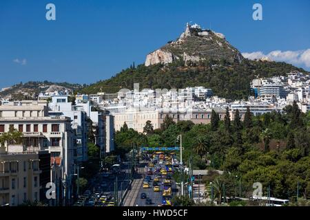 Greece, Central Greece Region, Athens, elevated view of Syngrou Avenue and Lycabettus Hill - Stock Photo