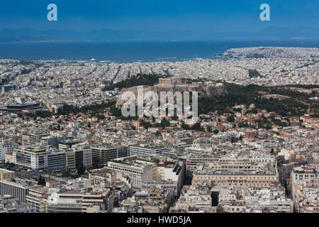 Greece, Central Greece Region, Athens, Lycabettus Hill, elevated city view with Acropollis - Stock Photo