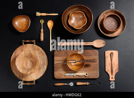 High Angle Still Life View of Collection of Wood Kitchen Objects - Wood Bowls, Cutting Boards, Spoons and Other - Stock Photo