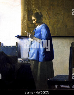 'Woman reading a letter' or 'Woman in Blue Reading a Letter'. ca. 1662-1663 Johannes Vermeer (1632 – 1675 ) Dutch - Stock Photo