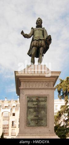 Miguel de Cervantes Saavedra's statue near the Spanish Congress of Deputies in Madrid, Spain - Stock Photo