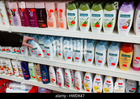 Aisle with a variety of shower gel products. - Stock Photo