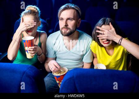 Friends in the cinema - Stock Photo
