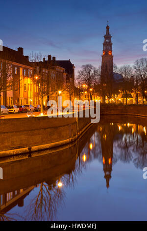 The city of Middelburg with the Lange Jan church tower in The Netherlands at night. - Stock Photo
