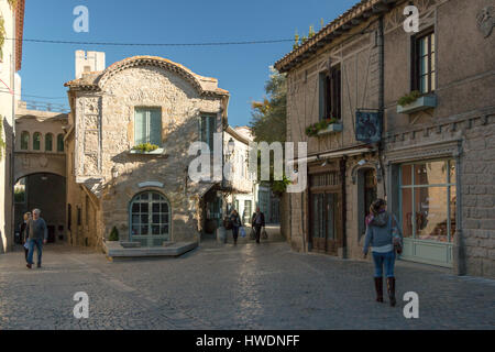 Tourists walking inside Carcassone Castle in France - Stock Photo