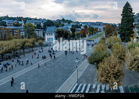 Pilgraims at the Sanctuary of Our Lady of Lourdes, France - Stock Photo