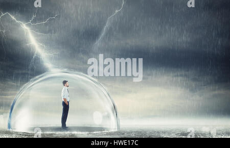 Businessman protected from the crisis - Stock Photo