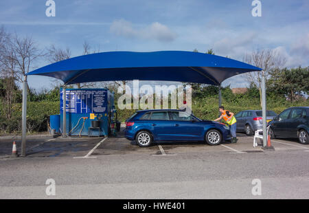 ... A Car Being cleaned at a Hand Car Wash Unit in a Car Park in Poole & Car wash worker UK Stock Photo Royalty Free Image: 58271177 - Alamy