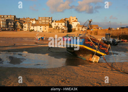 fishing boats at low tide, St Ives harbour, Cornwall, UK - Stock Photo