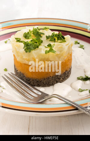 traditional scottish meal for burns night, haggis, swede and mashed potato on a plate - Stock Photo