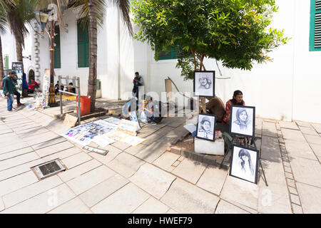 JAKARTA, INDONESIA - OCTOBER 9, 2016: Street artists wait for customers on the pedestrian street of Jakarta old - Stock Photo