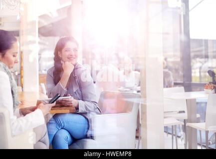 Businesswomen having working lunch in restaurant - Stock Photo