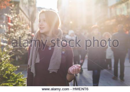 Young woman shopping at christmas market - Stock Photo