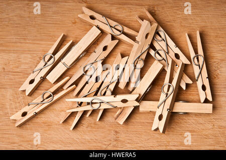 wooden clothes pegs scattered - Stock Photo