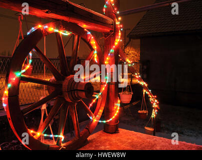 New Year shiny decorative lights were installed around the front porch of the house in small village near Novi Sad, - Stock Photo