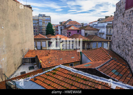 Red tiled roofs of residential buildings in Santo Ildefonso district of Porto city on Iberian Peninsula, second - Stock Photo
