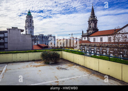 On the roof of parking lot in Santo Ildefonso district of Porto city in Portugal. View with City Hall tower (left) - Stock Photo