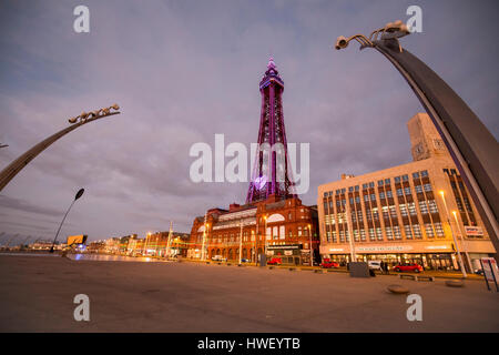 Blackpool -  a seaside resort on the Irish Sea coast of England. Blackpool Tower illuminated in purple light. - Stock Photo