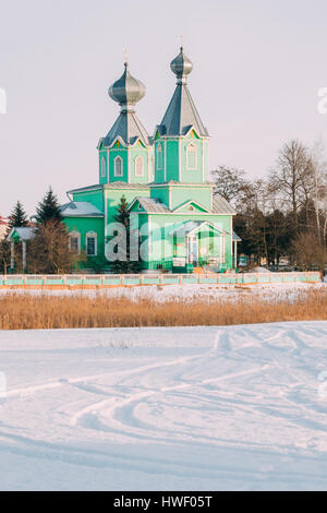 Old Wooden Orthodox Church Of The Holy Trinity In Village Krupets, Dobrush District, Gomel Region, Belarus. Sunny - Stock Photo