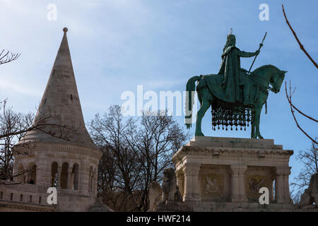Statue of King Stephen (Szent István szobra), and a tower of the Fishermen's Bastion (Halászbástya), Szentháromság - Stock Photo