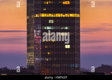 Modern office building detail, glass surface during sunset - Stock Photo