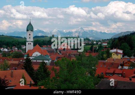 St. Andreas Church in Nesselwang and Allgäuer Alpen mountain range, Ostallgäu, Bavaria, Germany - Stock Photo
