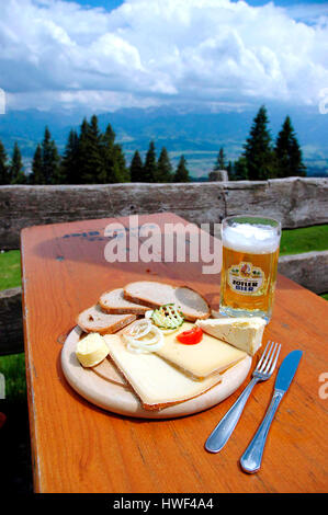 Lunch on a mountain hut, Mittagberg, Allgäuer Alpen, Upper Bavaria, Germany - Stock Photo