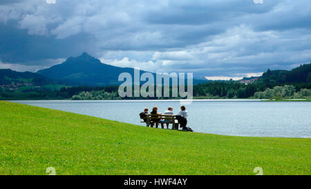Stormy clouds over the Gruentensee lake and reservoir dam with the Gruenten mountain in background, Wertach, Upper - Stock Photo