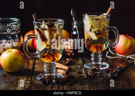 Apple Mulled Beverage with Cinnamon, Anise Star and Clove. - Stock Photo