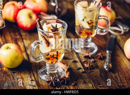 Hot Apple Cider Drink with Ingredients on Table - Stock Photo