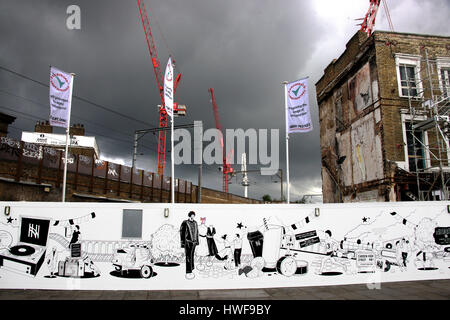 black and white mural on wall along road at Camden  market graffiti - Stock Photo