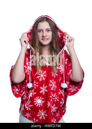 Lovely cheerful teenage girl posing in the studio. Wearing red winter hoodie with snowflakes. Isolated on white - Stock Photo