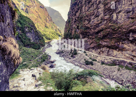 Beautiful Himalayan  Inspirational Landscape. Looking and Mountains and valley with river, forest and mountain road. - Stock Photo