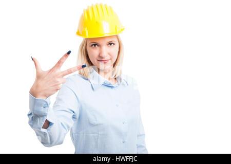 Female architect showing number three gesture isolated on white background - Stock Photo