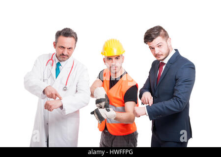 Doctor or medic, constructor and businessman pointing their wrist as punctuality or appointment concept on white - Stock Photo
